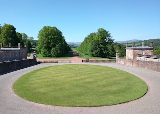 View of circular lawn and the entrance drive to Drumlanrig Castle, Scotland