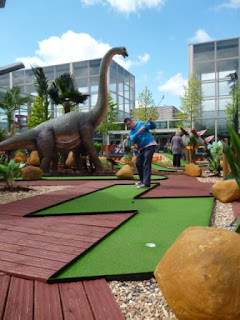 Playing a dinosaur themed minigolf course in Milton Keynes