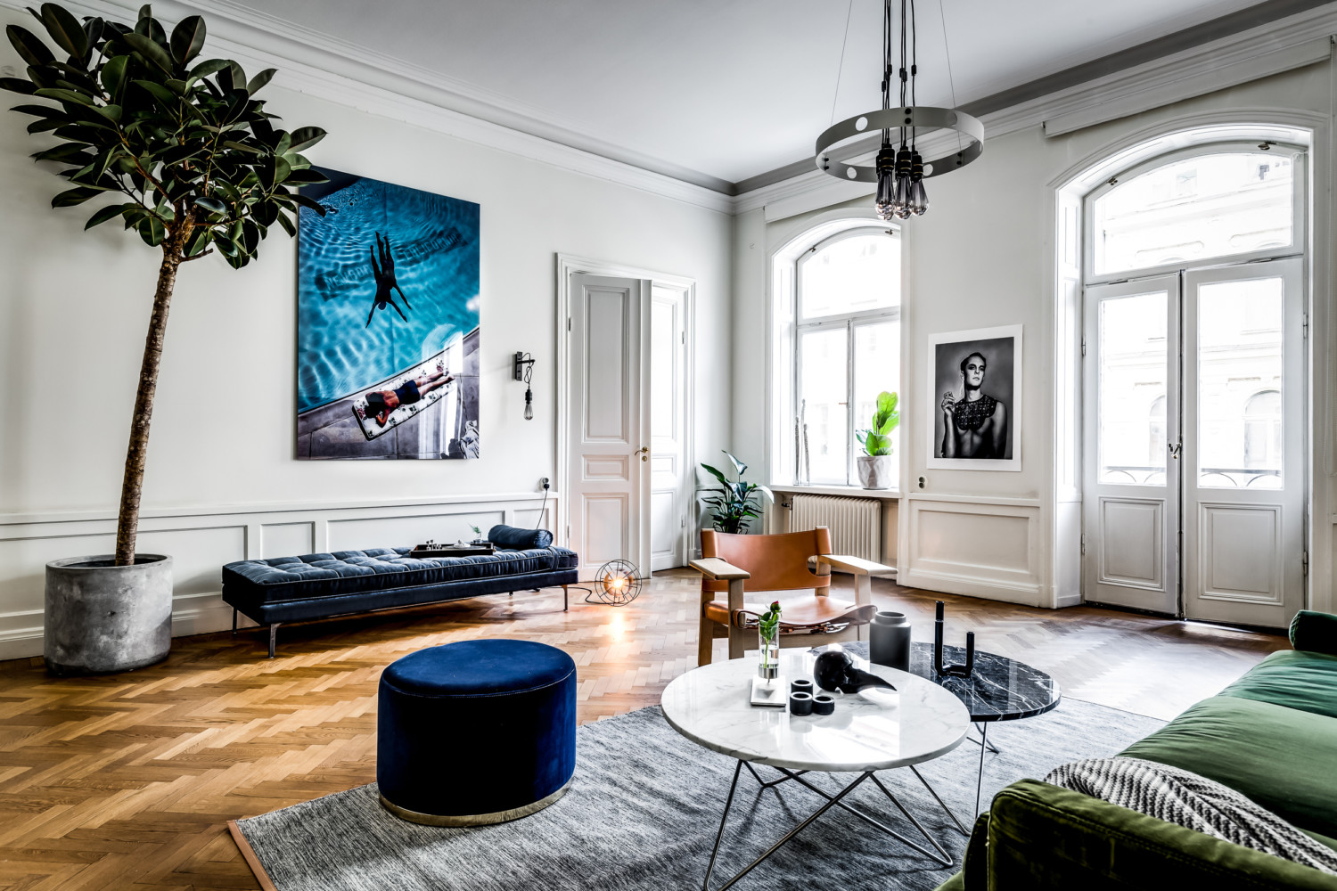 large scandinavian apartment, bohemian style living, eclectic apartment design, mid century furniture, double doors