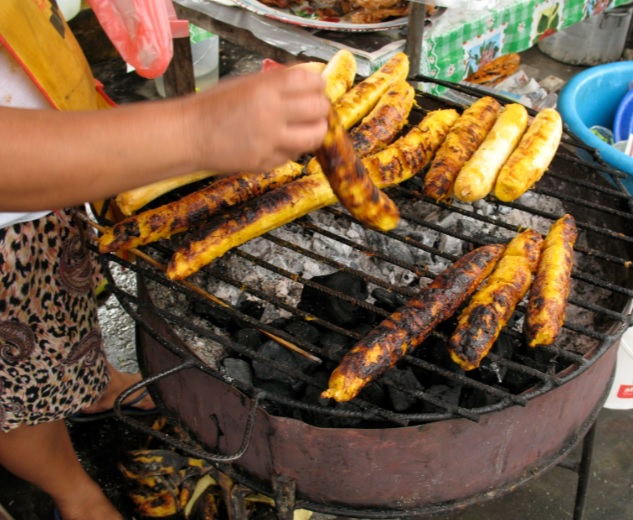 African street food hawkers teach how to grill sweet plantains perfectly.
