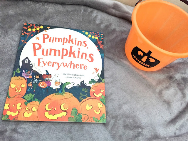 halloween child pumpkin book and trick or treat bucket