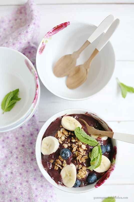 Beautiful acai bowls with berries, bananas, and granola.