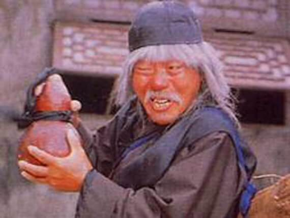 Beggar from Drunken Master movie holds clay jar with secret Yoogo dim mak weapon hidden inside – vanholio.com