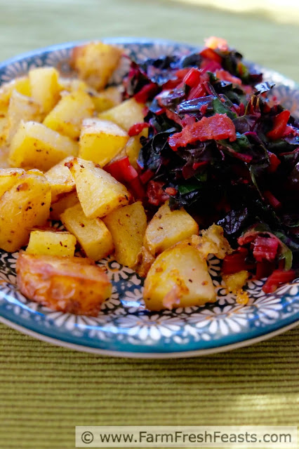 Fill your plate with vegetables--this dish consists of a heaping helping of sautéed Swiss chard and a side of roasted potatoes. A bit of bacon for flavor and you're ready to eat.