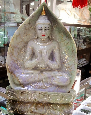 white sitting jade Buddha with gold