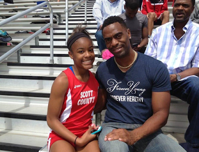 Tyson Gay and his daughter