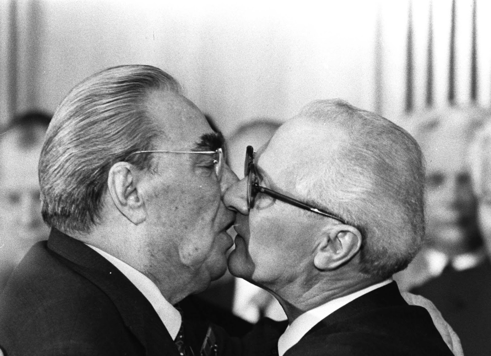 Soviet President Leonid Brezhnev and East German leader Erich Honecker change kisses after Brezhnev was honored with the title