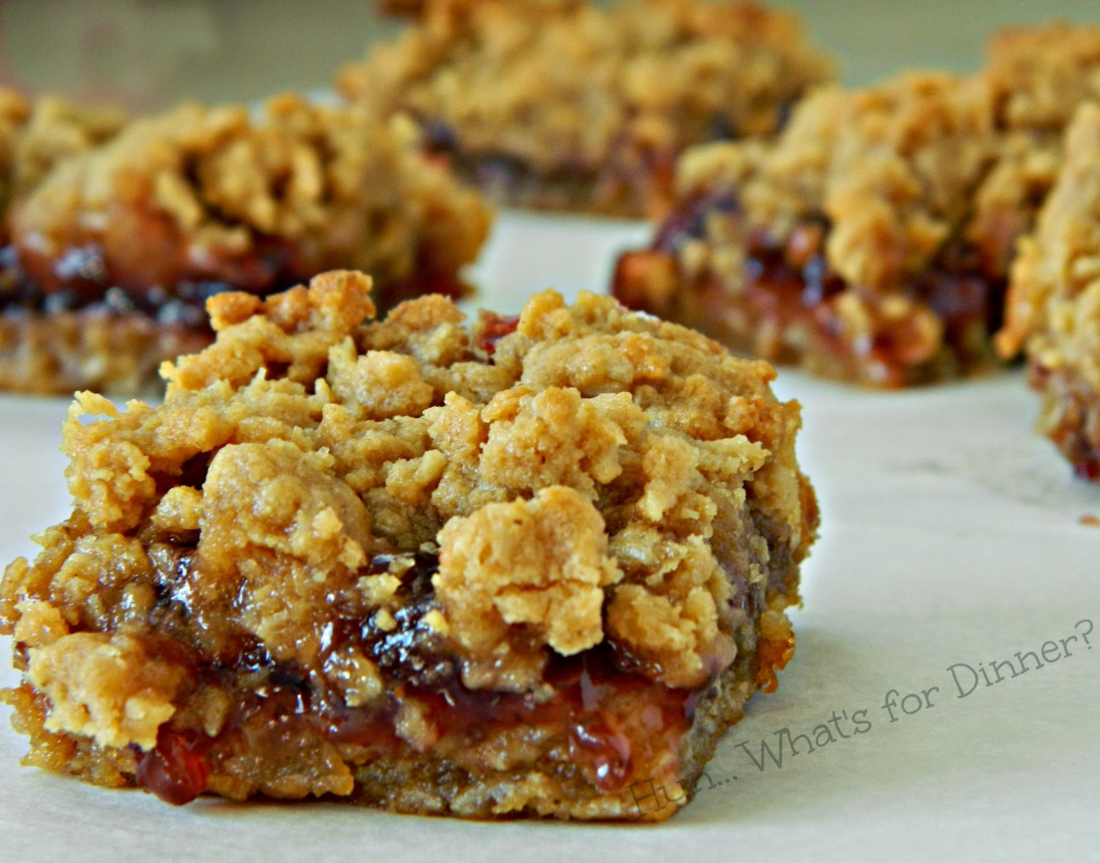 Hun... What's for Dinner? | Peanut Butter & Jelly Bars- These soft and chewy oatmeal peanut butter bars, have a gooey sweet layer of strawberry jam in the centre.