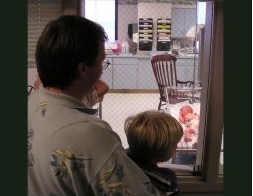 Image: Dad and son looking at newborn, by Ned Horton (Horton Web Design - HortonGroup.com) on freeimages