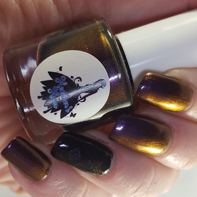 A purple to gold multi-chrome nail polish with hints of orange.