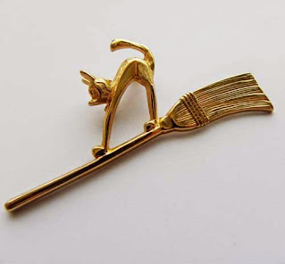 Cat on broomstick brooch by Avon