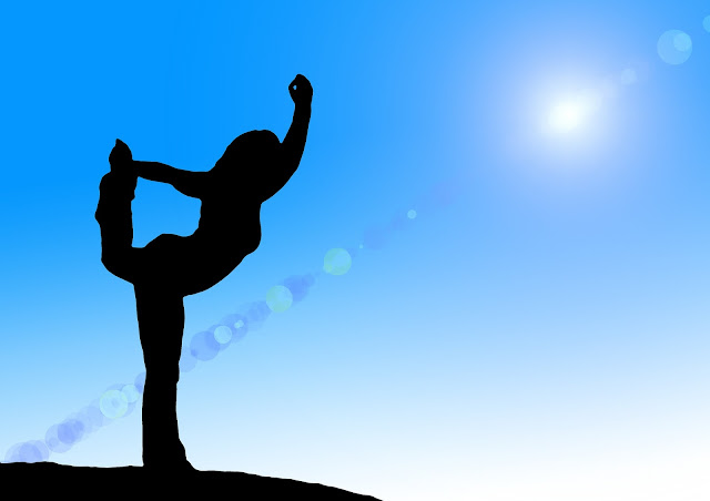 woman's silhouette, doing a yoga pose
