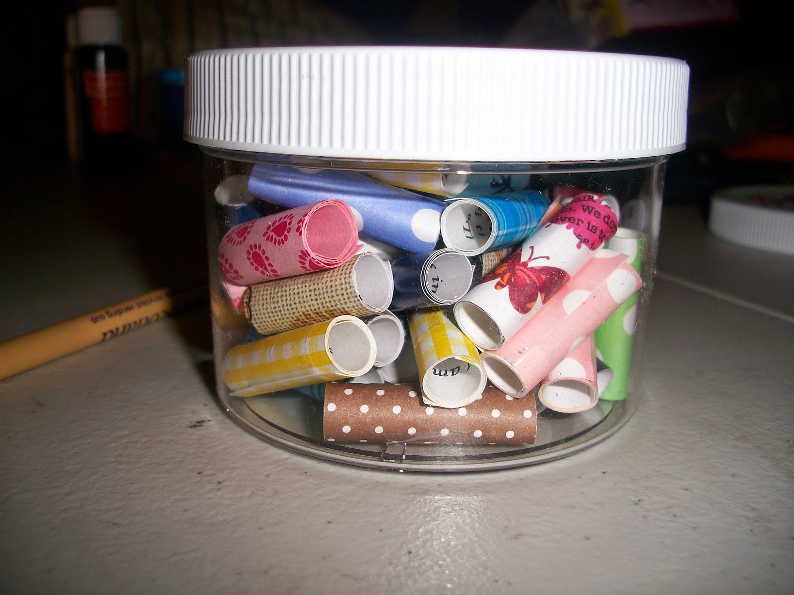 "DIY ""Joy Jar"" filled with 50 slips of paper with encouraging quotes or photos of cute animals."