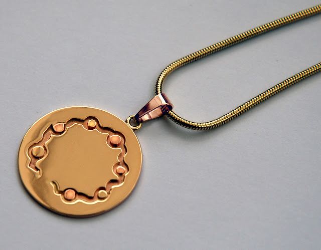 Anishinaabe graphic overlay pendant A River Flows Through My Heart