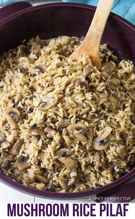 Savory Mushroom Rice Pilaf Recipe: Fluffy rice kissed with butter, sweet onions, garlic, sherry, herbs, and wild mushrooms!