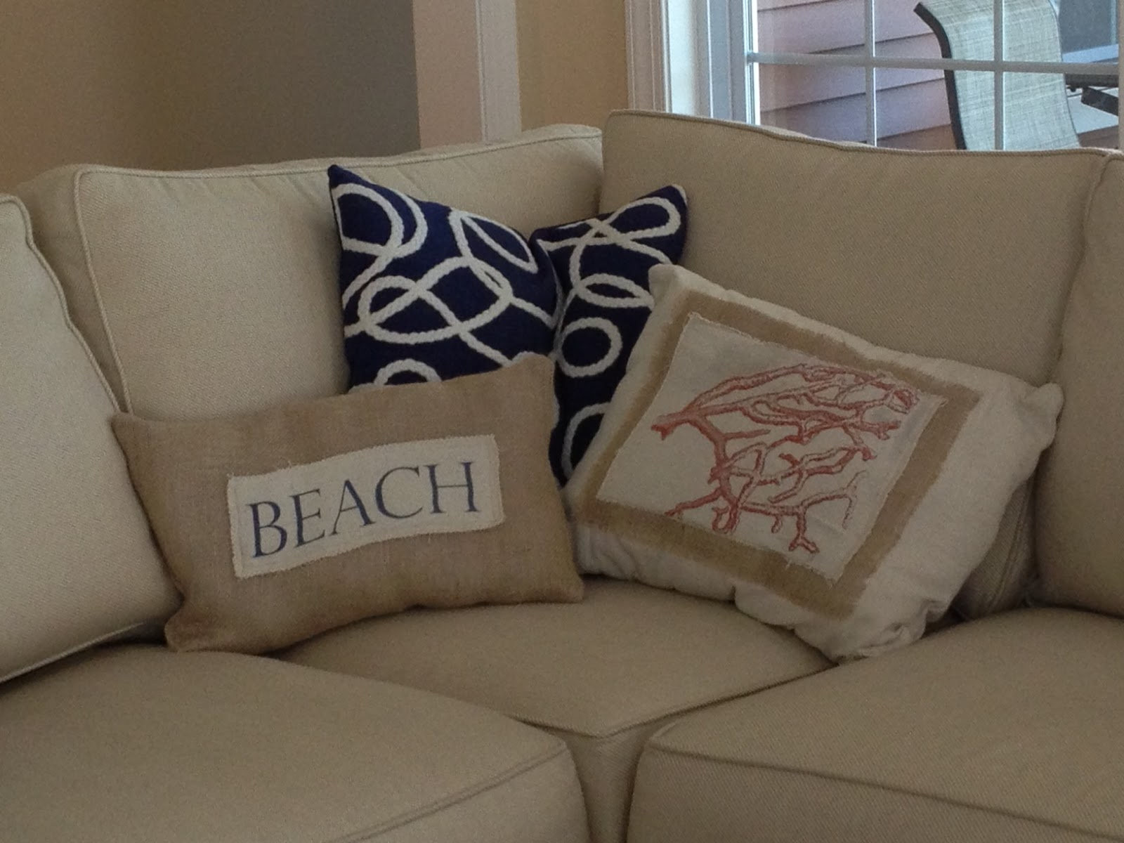 beach themed sofa pillows table behind two chairs it yourself diy throw on the cheap and easy
