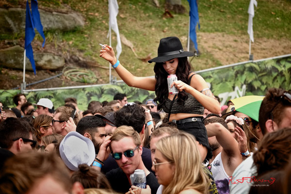 Festival style, black hat shoulder ride with a ciggie and a drink! Harbour Life Music Festival Sydney 2016. Photographed by Kent Johnson for Street Fashion Sydney.