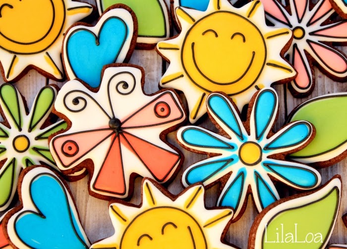 Decorated spring sugar cookies - happy sun, flowers, and hearts