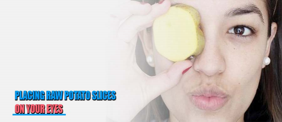 Placing Potato Slices in your eyes