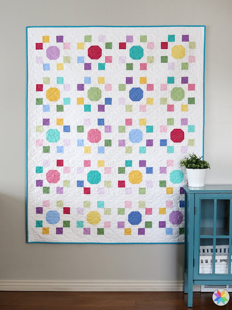 "Spot On quilt pattern by Andy of A Bright Corner - precut friendly using 10"" squares (layer cake) and the pattern has four sizes: crib, throw, twin, queen"