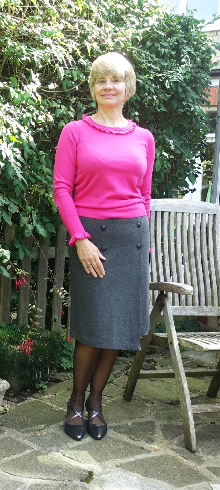Combine bright pink with grey for a colourful and contemporary work outfit