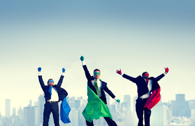 3 businessmen with masks and capes are masquerading as super heroes