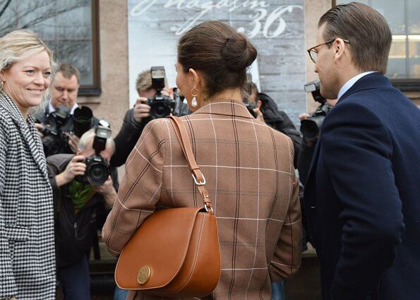 Crown Princess Victoria wore Acne Studios wool and cotton-blend suit, and Cravingfor Jewellery baroque pearl earrings