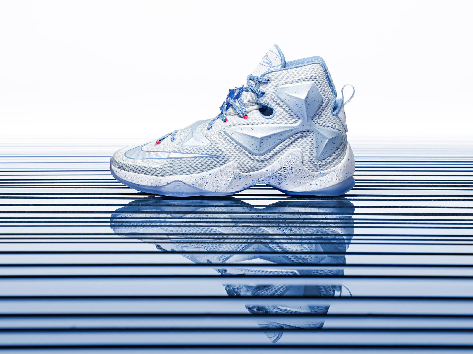 55784e02442 Fierce Midwest winters inspire the icy blue hues that run throughout the  LEBRON 13