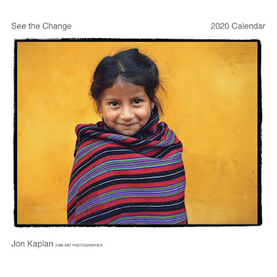 "Seva 2020 calendar which says ""see the change"" and identifies Jon Kaplan as the photographer; photo is of a little girl"