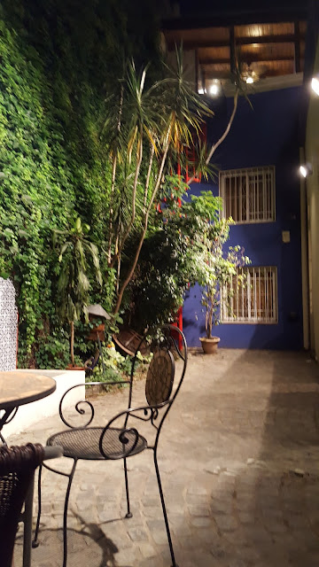 Casa chorizo patio at night with lighting