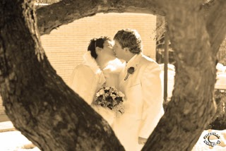 Professional sepia wedding portrait of bride and groom kissing with heart shaped tree photographed in Idaho Falls, Bonneville, Idaho by Cramer Imaging