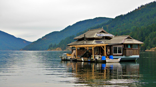 A float home bobs on the water of Burgoyne Bay off Salt Spring Island.
