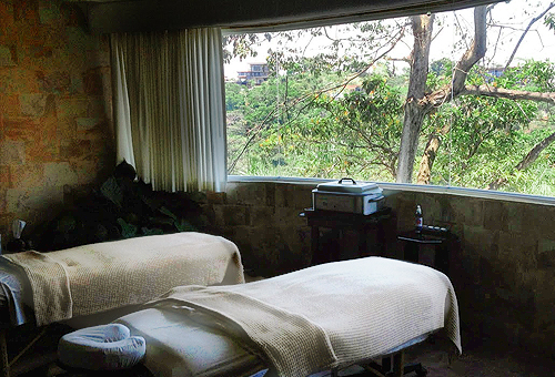couples massage room in a spa with two beds