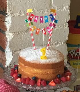 Bee's-first-birthday-cake-sponge-with-bunting-and-number-one-candle