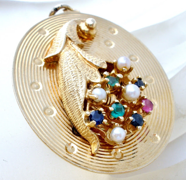 14K gold cornucopia pendant can be found here.