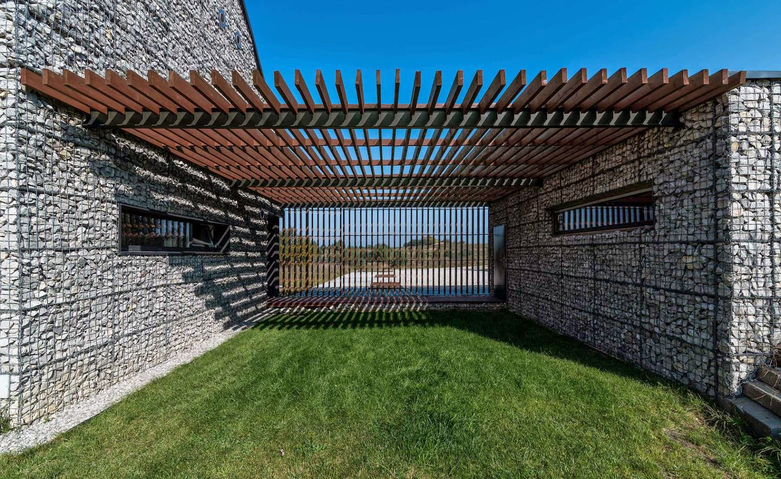 organic architecture gabion house. Black Bedroom Furniture Sets. Home Design Ideas
