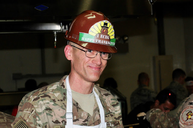 Yes, engineers wear hard hats to carve & serve dozens of turkeys to their troops.