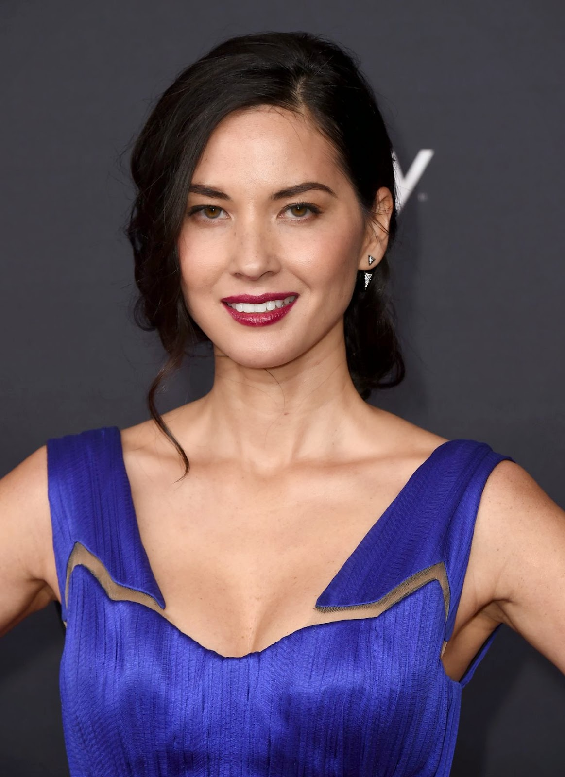 Olivia Munn in a stylish blue gown at the 2015 NFL Honors in Phoenix