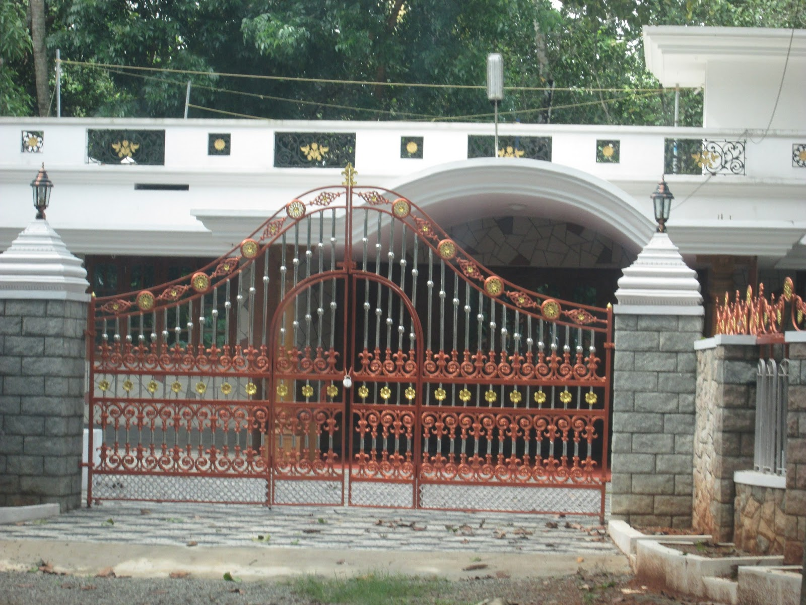 Kerala House Gate With Golden And Silver Colors Designs