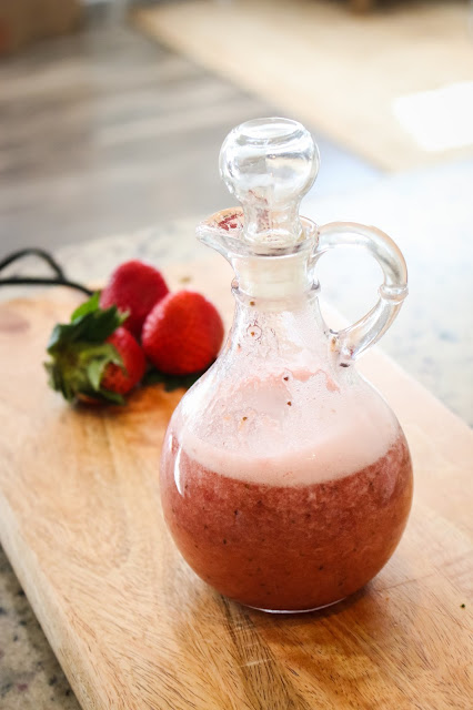 homemade strawberry syrup in a cruet