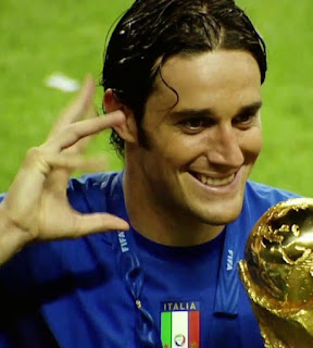 Luca Toni with the World Cup in 2006. The hand gesture is the one he habitually made after scoring a goal