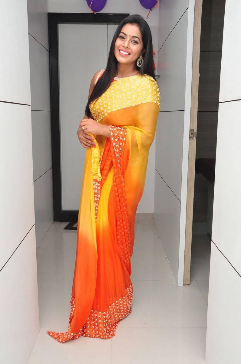 Poorna Latest Hot Stills In Orange Saree