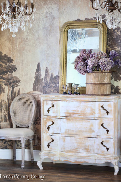 Vintage furniture with mural wall