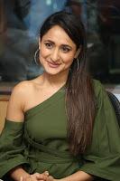 Pragya Jaiswal in a single Sleeves Off Shoulder Green Top Black Leggings promoting JJN Movie at Radio City 10.08.2017 011.JPG