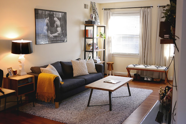 living room with furniture organized for photo opportunity and staged