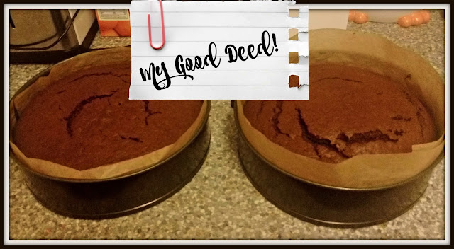 Two chocolate cakes on counter, in lined cake tins.