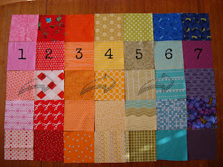 patchwork squares laid out in rows ready to be sewn