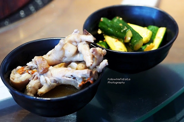sourish spicy pickled zucchini and chicken feet in herbal broth.