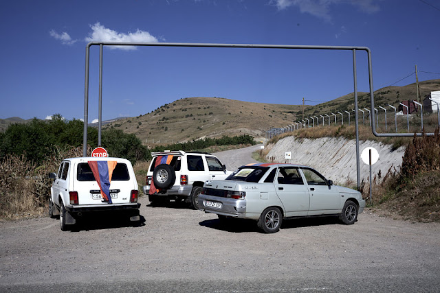 Image Attribute: Cars draped in Armenian flags at Blockade Number Three / Photo: Klaus Richter