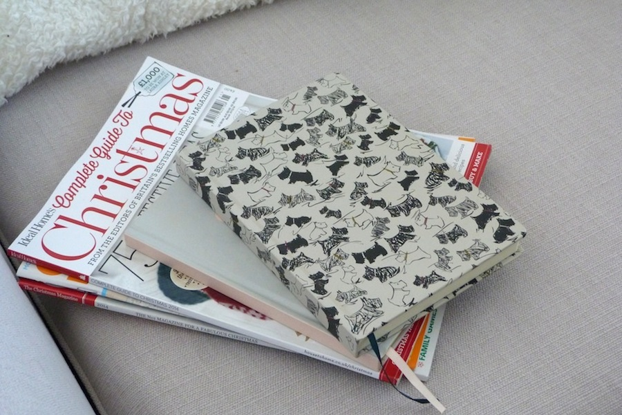 an image of Christmas magazines and notebooks